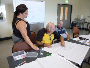 Elders working hard on the sculpture plan, guided by facilitator Ingrid Cumming.